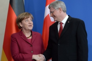 Prime Minister Stephen Harper take part in a joint press conference with German Chancellor Angela Merkel at the Chancellery in Berlin, Germany, March 27, 2014. THE CANADIAN PRESS/Sean Kilpatrick