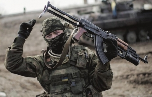 A Ukrainian soldier gestures as he guards territory near Debaltseve, eastern Ukraine, Sunday. The government-held town of Debaltseve, a key railway junction, has been the epicentre of recent battles between Russian-backed separatists and Ukrainian government troops. Photograph by: Evgeniy Maloletka, The Associated Press, Postmedia News