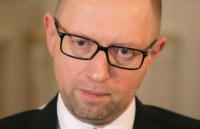 Ukrainian Prime Minister Arseniy Yatsenyuk talks with reporters during an interview with the Associated Press in Kiev, Ukraine, Friday, March 27, 2015.