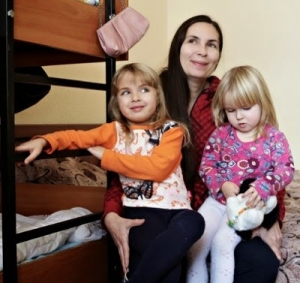 Businesswoman Oksana Kolyada, 35, with the daughters she took with her on fleeing Luhansk, which is controlled by pro-Russia separatists.