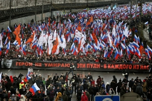 Thousands marched in Nemtsov's memory two days after the opposition leader was killed in front of the Kremlin. Nemtsov had been set to lead a large rally against Putin's war in Ukraine; instead, the demonstration turned into a cortege in his honor.