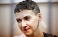 In this March 26, 2015, file photo, Ukrainian jailed military officer Nadezhda Savchenko attends a court hearing in Moscow. Maria Shavchenko, the mother of a Ukrainian helicopter pilot imprisoned in Russia is on a global campaign seeking support from world leaders to pressure President Vladimir Putin to free her daughter, Nadezhda Savchenko.