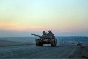 ANDREY BORODULIN / AFP/GETTY IMAGES. A tank carrying pro-Russian separatists rides on a road in eastern Ukraine on Tuesday. As Western countries prepare to send military advisers to the region, the possibility of a collision with Russian forces cannot be ruled out, writes Thomas Walkom.