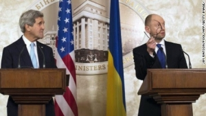 Ukraine Prime Minister Arseniy Yatsenyuk (R), in Kiev with U.S. Secretary of State John Kerry, offers his glasses to Russian President Vladimir Putin.