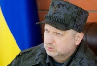 "Oleksandr Turchynov, Ukrainian National Security and Defense Council Secretary, accused Ukrainian TV channel Inter of ""acting against the Ukrainian state"" by broadcasting pro-Russian separatist sympathizers on New Year's Eve."
