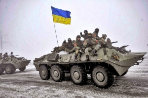 Ukrainian servicemen sit atop an armored personnel carrier (APC) as they patrol Orekhovo village in Luhansk region January 28, 2015.