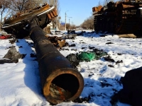 The wreckage of a Ukrainian army tank sits in Uhlehorsk near Debaltseve on Feb. 18, 2015.