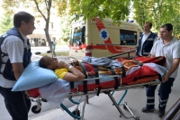 Medical workers move a wounded Ukrainian soldier to a waiting ambulance in September at the Kyiv Military Hospital. [AFP]