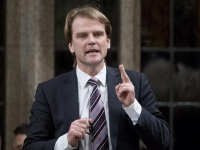 Minister of Citizenship and Immigration Chris Alexander responds to a question during Question Period in the House of Commons Monday March 9, 2015. Adrian Wyld / THE CANADIAN PRESS