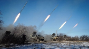Pro-Russian rebels stationed in the eastern Ukrainian city of Gorlivka, Donetsk region, launch missiles from Grad launch vehicles on February 18, 2015. PHOTO/AFP