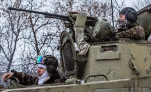 Ukrainian soldiers prepare to drive in the direction of the embattled town of Debaltseve on Feb. 16, 2015, in Artemivsk, Ukraine. A cease-fire that went into effect two days ago has been generally respected aside from Debaltseve, where pro-Russian rebels claim to have surrounded thousands of Ukrainian fighters and the battle continues.