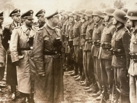 The June 3, 1944 photo provided by the U.S. Holocaust Memorial Museum shows Heinrich Himmler, centre as he reviews Nazi troops of the Galician SS-Volunteer Infantry Division.