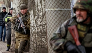 Pro-Russian rebels take cover, during what the rebels said was an anti-terrorist drill in Donetsk.